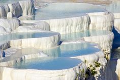 Pamukkale - Pamukkale is known locally as the 'Cotton Castles', the odd formations of the area are caused by warm, calcium-rich water flowing over the cliff edge and cooling in the process, building natural pools and shelves in the process. Right at the top of these pools is Pamukkale thermal, where you can enjoy a dip in the warm waters, which were thought by the Romans to have healing powers.