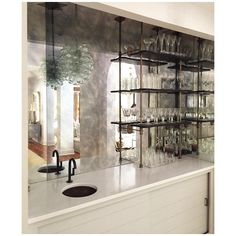 "Nancy Price Interior Design on Instagram: ""bar area we designed for a client, with a custom paneled sliding cabinet door, an antique grape cluster chandelier, and a shelving system that is fully adjustable. loving the feel of this functional and beautiful space that was transformed from a small closet. #nancyprice #nancypriceinteriordesign #bar #interiordesign #homedesign #design #homedecor #bararea #custom"""
