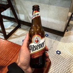 A lil Pilsener while waiting for some food #liverbashers #local08% #beer #elsalvador #pupusa #salvadorean #southamerica #drinking #import