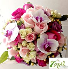 #Cancunflorist  Floral design for weddings in Cancun & Mayan Riviera.  www.floreriazazil.com #bridalbouquet #rosesandorchidsbouquet #cancunweddings #pinkwhiteandpurplebridalbouquet