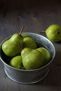 Rather than going mad with table flowers... pears?