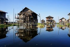A traditional floating village composed of stilt houses on Inle lake in Myanmar. Made of wood and woven bamboo, many of these homes are surrounded by floating gardens. Everything here is undertaken by boat.