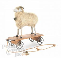 "Realized Price: $ 729    Stick leg sheep pull toy, ca. 1900, 6 1/2"" h., 7"" l."