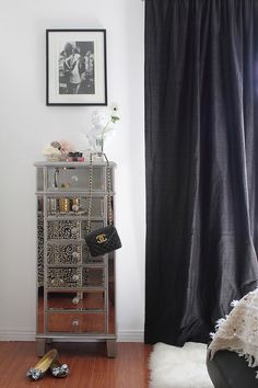 Pier One's Hayworth Collection Lingerie Chest, white shag area rug, and black floor to ceiling curtains.