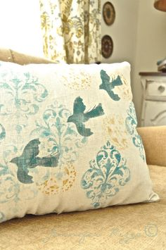 Stenciled linen pillows - Jennifer Rizzo - Mix up different stencils on a fabric, then sew your pillow. Easy!