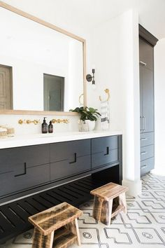 Bathroom with patterned tile, white countertops and gold hardware Brothers cement tile#77