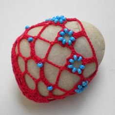 """Made by nature river stone embellished with turquoise beads and red crocheted lace will add some charm to your home decor. Great for Florida rooms, beach homes, cottage style homes, southwestern style homes or as a paper weight for your office. Great gift for a teacher or a babysitter.     Size: 3.5"""" x 3"""" x 2"""" thick    READY TO SHIP."""