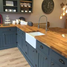 Dark blue painted cabinets and butcher block wi… Modern farmhouse kitchen design. Dark blue painted cabinets and butcher block with farmhouse sink. Kitchen Decorating, Home Decor Kitchen, Kitchen Interior, New Kitchen, Cheap Kitchen, Apartment Kitchen, Kitchen Hacks, Kitchen Furniture, Wood Furniture