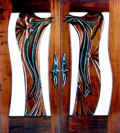 """""""Sensuality in Bronze"""" by Fine Woodworks Custom Doors. This set of solid mahogany doors' main feature is a flowing bronze accent piece and handles. Made of Hand-Carved Honduran Mahogany and Bronze. Visit our website for additional photos and pricing. Wooden Double Doors, Wooden Doors, Door Gate Design, Rustic Doors, Custom Wood, Entry Doors, Accent Pieces, Beautiful Images, Art Nouveau"""