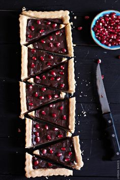 A 6-ingredient, 15-minute, Delectable Shortbread Tart filled with a Smooth Dark Chocolate Ganache and sprinkled Pomegranate Arils.