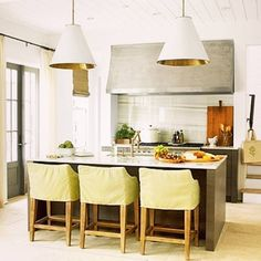 Cheerful kitchen with island vibe and bright tones featured in Coastal Living's Ultimate Beach House designed by Erika Powell who picked #Goodman by @visualcomfortco as her lighting choice.
