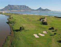 Milnerton Golf Club with Table Mountain and Table Bay in the background and the Milnerton Lagoon on the left of the photo. Public Golf Courses, Best Golf Courses, Cape Town Tourism, Coeur D Alene Resort, Cape Town South Africa, Port Elizabeth, Table Mountain, Dream City, Most Beautiful Cities