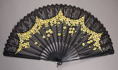 Victorian fan:  black lace and tiny yellow flowers
