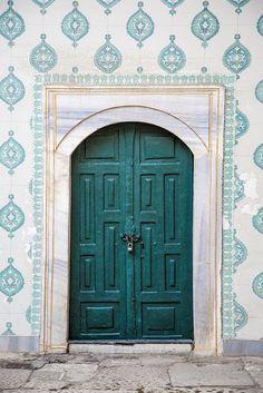 turquoise door with white & aqua borders