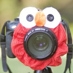 Elmo around your camera lens, makes the kids smile on your photo: Every time!