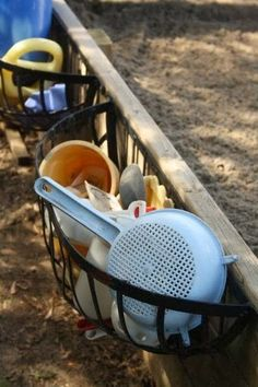 What a clever way to store sandpit goodies. Simply screw planters onto the sides of a wooden sandpit.