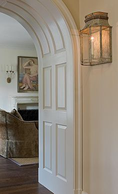 Paneling l Anne Decker Architects | Selected Works | Renovations | Tudor Renovation..Nierman Weeks wall sconce's. This would be a great addition to put above the bathtub in the master bathroom.