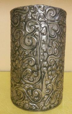 Metal embossing glued to coffee tin, by Lenette Theron.