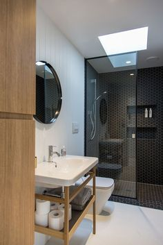 The home's compact bathroom is located in its central service core. Photograph by Jeremy Toth.