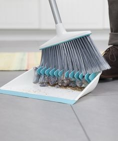 White Broom Groomer Set by Quirky  his innovative dustpan features rubber teeth to comb out dust bunnies, while a smooth front keeps it flush with the floor to prevent anything from slipping through the cracks. Plus, a clever built-in foot pedal allows for hands-free sweeping. 14.25'' W x 12.25'' H x 2.75'' D Plastic / rubber / nylon