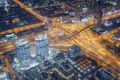 "Dubai Yellow Rush - This is a shot taken in Dubai from Burj Khalifa. The light trails of the cars gives a magical feeling to the image. Also The Sheikh Zayed highway is a very impressive interchange.   Enjoy!  Visit my: <a href=""https://www.facebook.com/tasoskphotography""> FB Page </a> - <a href=""https://twitter.com/Tasko83""> Twitter  </a> - <a href=""https://plus.google.com/106699010166117105623/posts"">Google+</a> © Copyright Tasos Koutsiaftis. No usage permitted without prior written…"