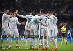 Cristiano Ronaldo Photos - Cristiano Ronaldo of Real Madrid celebrates with Karim Benzema after scoring his team's second goal during the La Liga match between Real Madrid and Getafe at Estadio Santiago Bernabeu on March 3, 2018 in Madrid, Spain. - Real Madrid vs. Getafe - La Liga