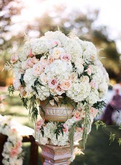 pastel ceremony floral arrangement - photo by Gina Meola Photography http://ruffledblog.com/gem-toned-garden-wedding-in-arizona