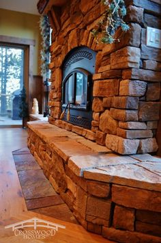 A wall to wall hearth, and efficient wood stove insert make this fireplace just as much functional as it is beautiful. by Crosswood Homes, Inc. Custom Home Designs, Custom Homes, Woodland Park Colorado, Bring The Heat, Park Homes, Spring Home, Rustic Style, Home Builders, Hearth