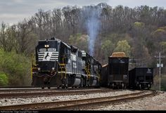 NS T12 rumbles into Clinton with an awesome lash-up of 3 GP38-2's, with two of them being high hoods!