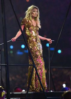 Kate at the closing ceremonies of the Olympics, wearing a gown by Alexander McQueen.