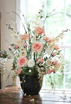 My son was married this past summer, and my sweet soon-to-be daughter-in-law askedme if I could make a silk floral arrangement for a large cement urn that
