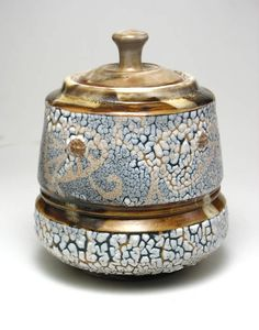 Joel Blum  finally a crackle glaze application I love. It's that wonderful contrast with the flat rich gold and the ghostly underglaze!