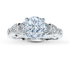 Gorgeous and I usually don't prefer the round cut but I love this. Click on it, the side view is equally as gorgeous