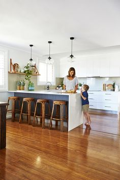 Get The Look: Coastal Kitchen Design On A Budget To match the rest of her resort-style home, Anna went with a coastal kitchen design when renovating with simple white cabinetry, hints of timber and a stone Caesarstone benchtop. Coastal Style, Coastal Decor, Coastal Cottage, Coastal Interior, Modern Coastal, Hamptons Kitchen, Simple Kitchen Design, Beach House Kitchens, Coastal Living Rooms