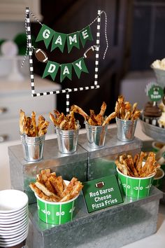 Game Day Party - The adorable Field Goal is an easy DIY. Simply use hot glue to attach four paper straws in the shape of a Field Goal! Then use the FREE Printable Mini Banner and tie to the Field goal. Use hot glue to attach each banner piece on the twine.