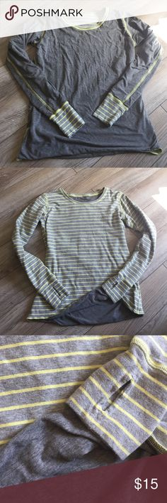 Thick warm long sleeve tee Reversible striped long sleeve top, thumbholes, no tag, can be worn solid gray or with yellow stripes. Great condition. Tops Tees - Long Sleeve