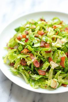 Brussels Sprouts Bacon Salad - Shaved brussels sprouts tossed in a tangy, sweet vinaigrette with crisp, crumbled bacon!