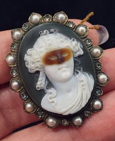 """Becky Stone  on Instagram: """"Look at this totally insane masquerade #cameo from @cynthiafindlayantiques. I've never seen anything like her. #antiquejewelry #OMBAS2016 #OMBAS #jewelryhunting"""""""