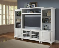 entertainment center... this piece of furniture is used to display your television along with all your other media equipment. generally, there is also storage space for cds and dvds as well