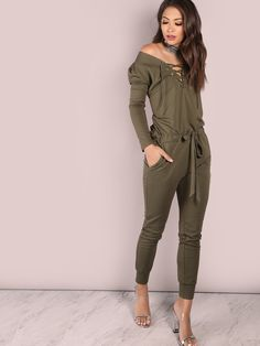 """Simply effortless yet so stylish, the Oversized Open Shoulder Jumpsuit will make even your laziest of days a winner. Featuring a jumpsuit with a lazy fit look, lace up bust detailing, two side pockets, a tieable waist and comfortable stretchy cotton material. Jumpsuit measures 57.5"""" in. from top to bottom hem. Team with barely there heels and silver hoop earrings. #olive #MakeMeChic #style #fashion #newarrivals #winter16"""