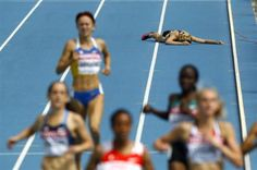 Nikki Hamblin of New Zealand lays on the track after falling during the women's 1,500 metres heats at the IAAF World Championships in Daegu August 28, 2011.  REUTERS/David Gray