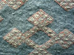 a woven pattern. Hedeby. Denmark, Museum Showcase. Reconstruction of tissue.