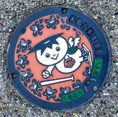 q10394 Pretty Japanese manhole lids.