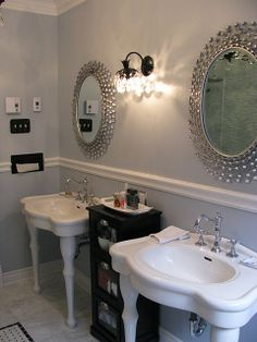 I've always liked these sweet little sinks, but love them more with the mirrors and that great old light fixture! Beautiful in white and gray with accents of black... (@Remodelaholic.com)