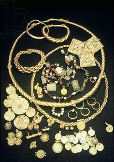 The Hon Hoard (gold) / Viking / deposited near Horn, Norway, c.860.:  trefoil brooch top left is Carolingian; torque necklace and bracelet are Northern European; coins have Arabic markings / Viking Ship Museum, Oslo