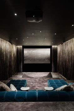 Sleek drapery-wrapped home Theater