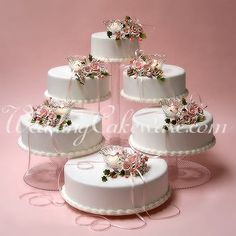 """cascading wedding cake stands   Components included: (2) 8"""" plates, (4) 10"""" plates, (4) 12"""" plates, (1 ..."""