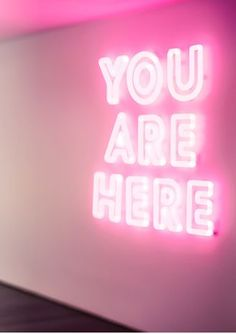 Ya Party Girls! Are you here with us?! This pink and neon 'You Are Here' wall looks like a total party to us!