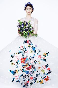 Tulle gown with Tree of Life embroideries by Valentino. Trinity Ruban platinum solitaire ring with diamonds by Cartier, price upon request. Bouquet by Gardenia Organic.