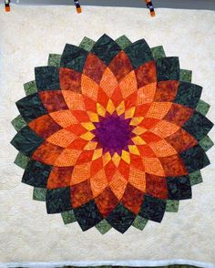 """We LOVE Linda's """"Giant Dahlia"""" quilt! Gorgeous colors and quilting. (Especially those flowers in the background!)"""